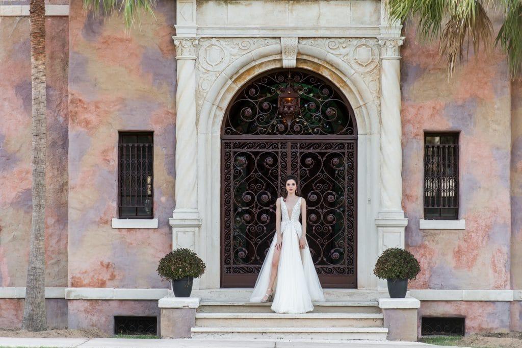 The Howey Mansion - bride in front of beautiful wrought iron door