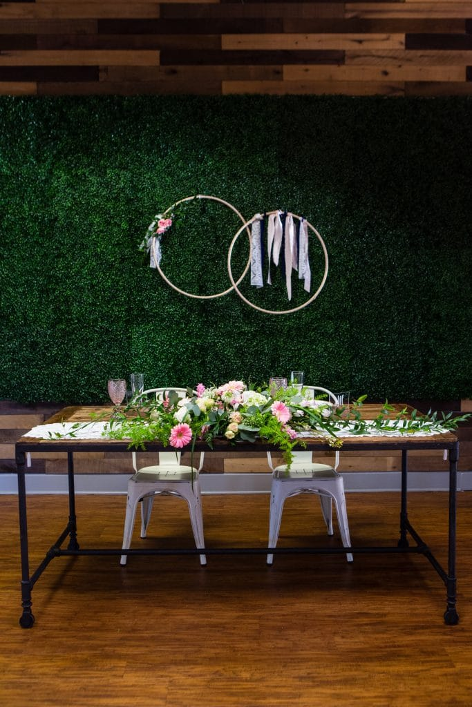 Hub 925 - sweetheart table with vine wall backdrop