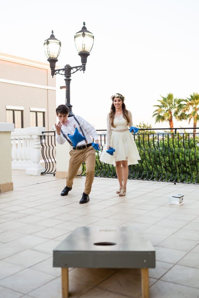 Hub 925 - bride and groom playing cornhole