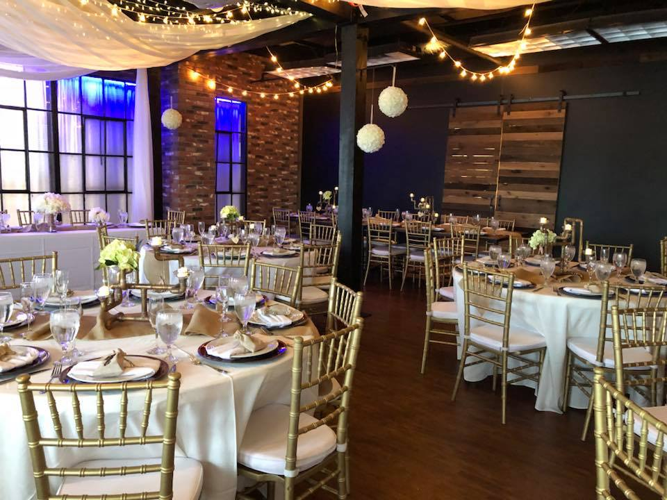 Hub 925 - reception space with white ceiling drapes and brick wall