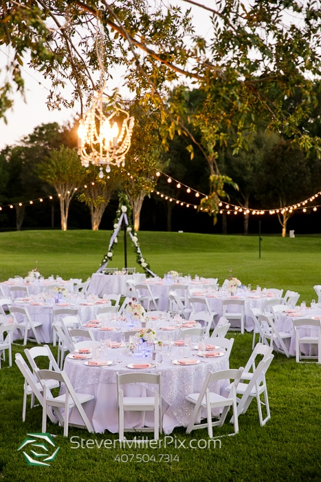 Hyatt Regency Grand Cypress - outdoor reception tables with market lighting and chandelier