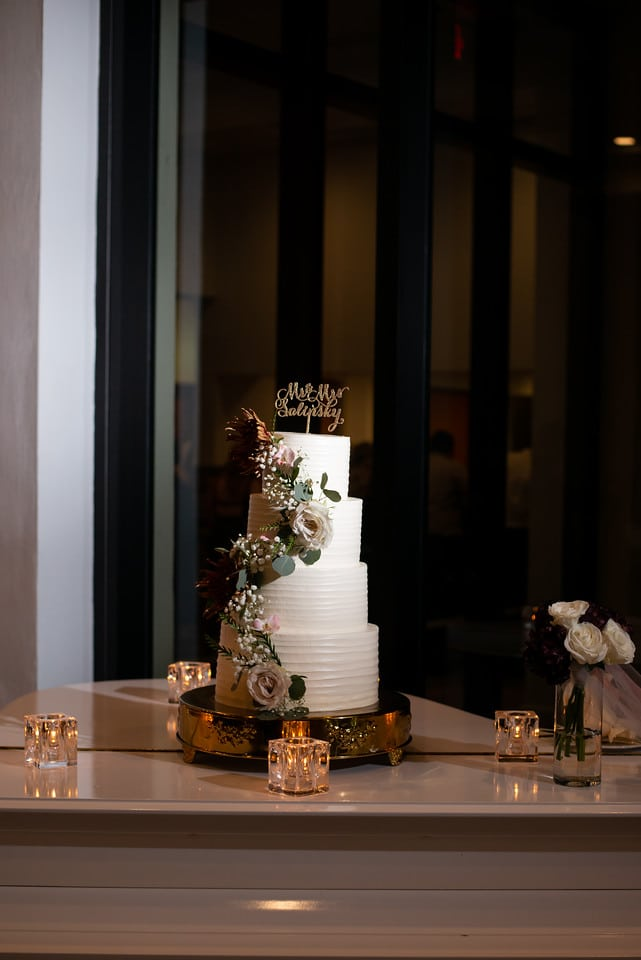 Hyatt Regency Grand Cypress - simple tiered wedding cake with floral cascade