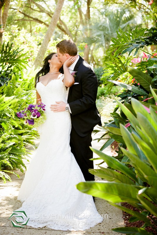 Hyatt Regency Grand Cypress - bride and groom in tropical setting