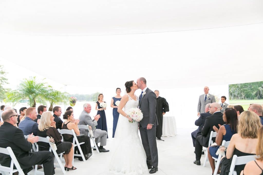 Hyatt Regency Grand Cypress - bride and groom kiss mid-aisle