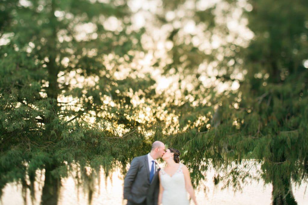 Hyatt Regency Grand Cypress - bride and groom kissing beside lake