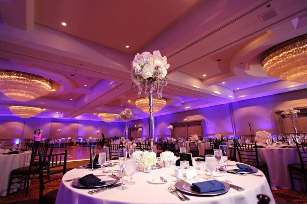 Hyatt-Regency-Orl-Ballroom set up with lavendar and silver decorations and tall floral table center pieces