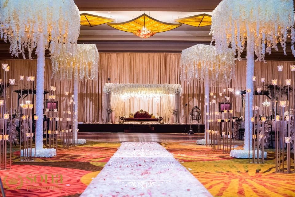 Hyatt-Regency-Orl-Ballroom deocrated with lavish lights with couch for Bride and Groom ceremony