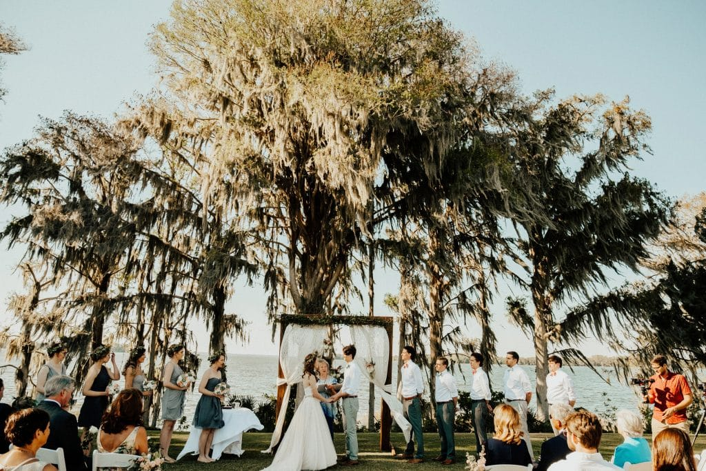 wedding ceremony under a moss-covered oak tree