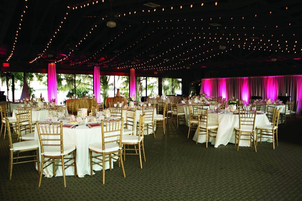 Mission Inn Lakefront Wedding Reception Marina with market lights and pink uplights