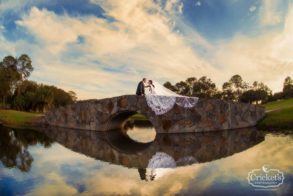 bride and groom on stone bridge at Mission Inn Resort golf course