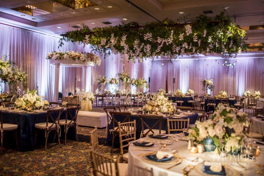 grand ballroom wedding venue Mission Inn Resort white draping hanging flower ceiling installation