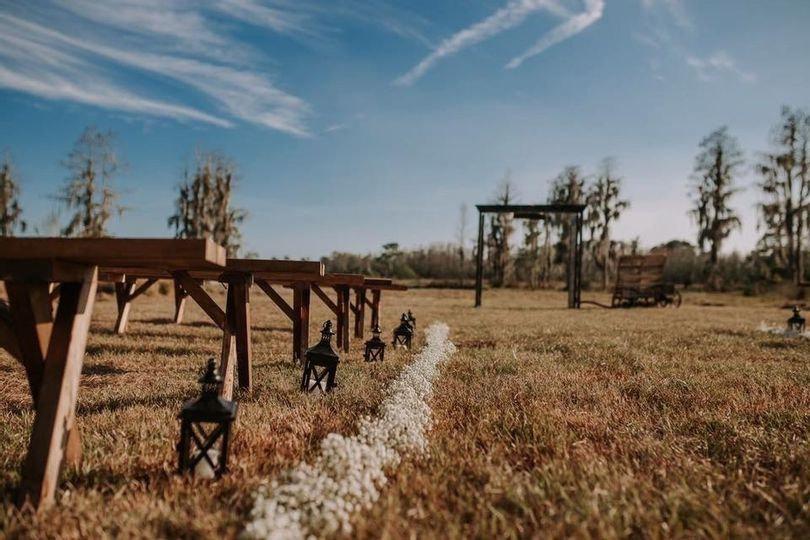 outdoor wedding ceremony with wooden benches clermont florida farm