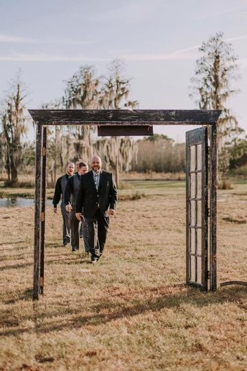 groom and groomsmen wedding entrance at mystical winds