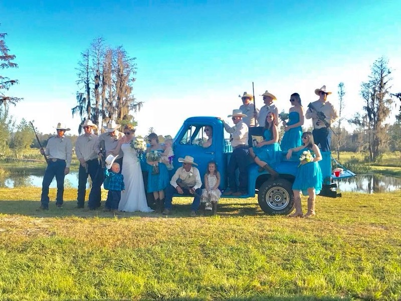 Mystical Winds blue pickup truck in field for country wedding