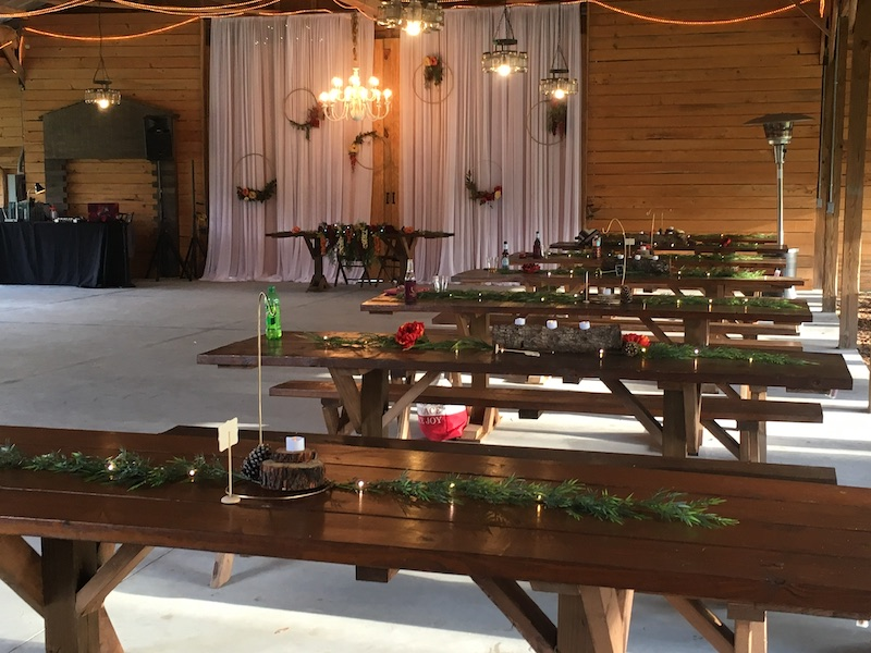 Mystical Winds wedding tables setup inside barn for wedding reception