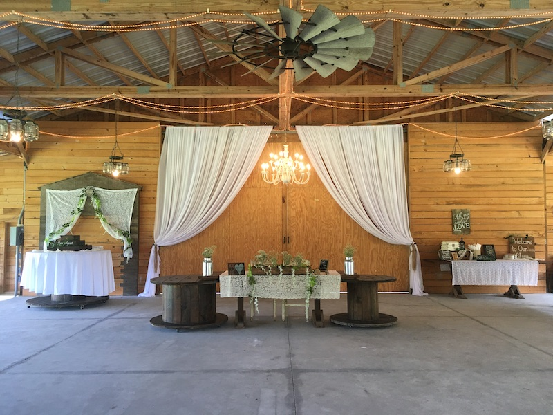 Mystical Winds big inside of barn setup for wedding reception