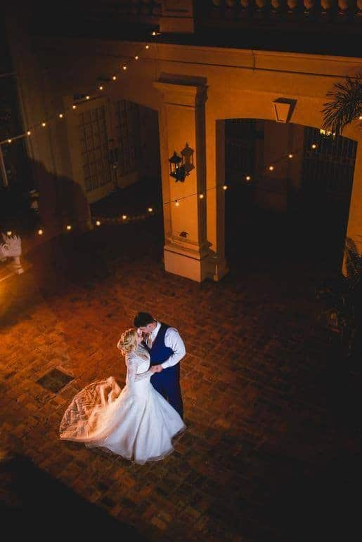 Orchid-Garden-at-Church-Street-Bride and Groom dancing alone outside under lights