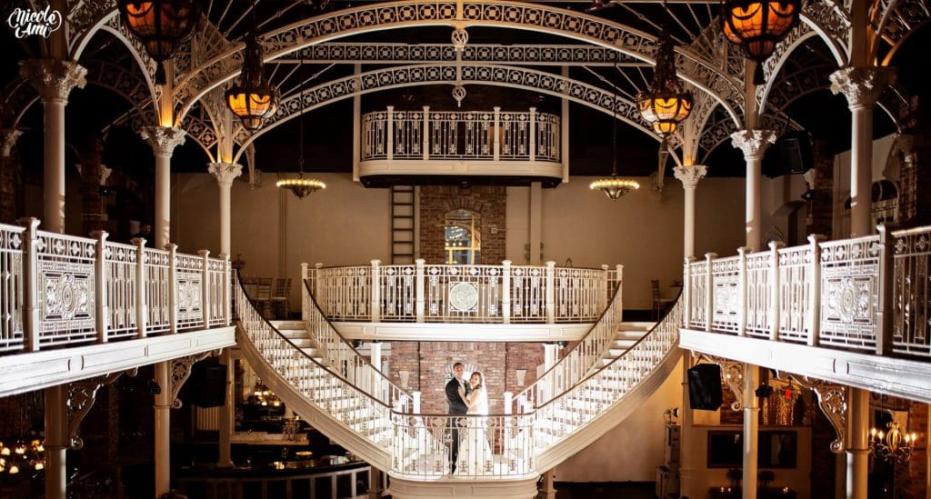 Orchid-Garden-at-Church-Street-Bride and Groom on a grande staircase