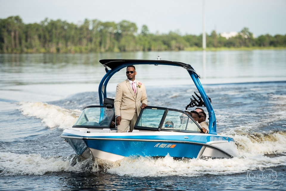 Paradise Cove - groom arriving on boat