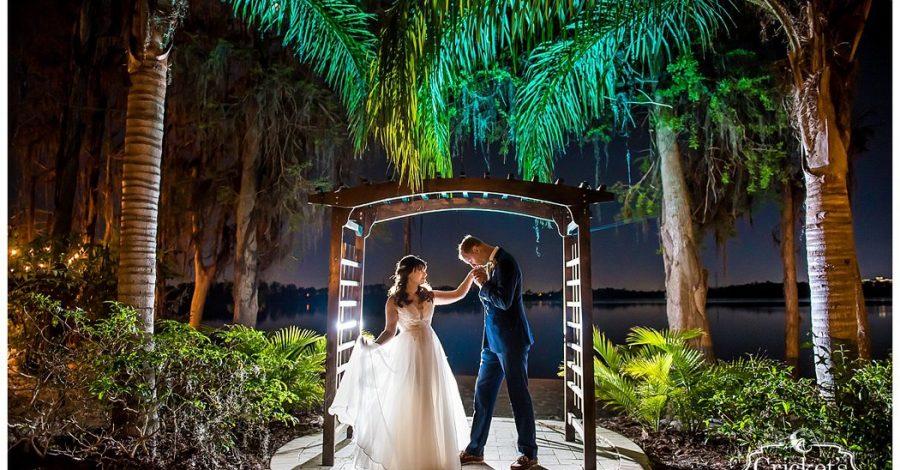 Paradise Cove - groom kissing bride's hand under tropical pergola