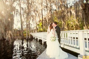 Paradise Cove - bride and groom kissing beside bridge over lake