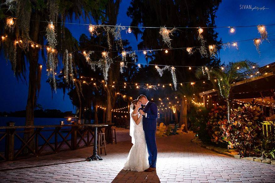 Paradise Cove - bride and groom dancing under moss-covered market lighting