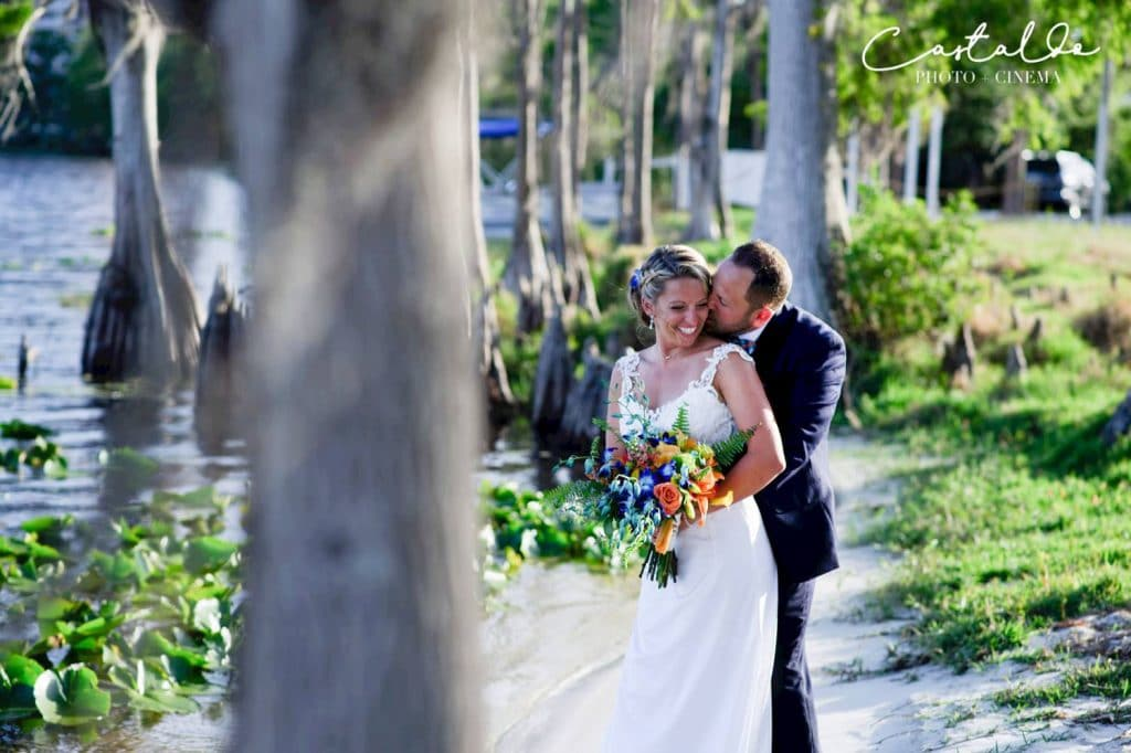 Paradise Cove - bride and groom next to Cypress trees