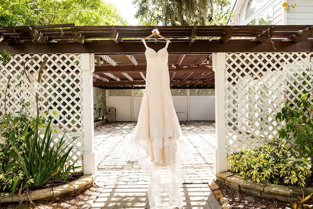 Paradise Cove - wedding dress hanging under patio