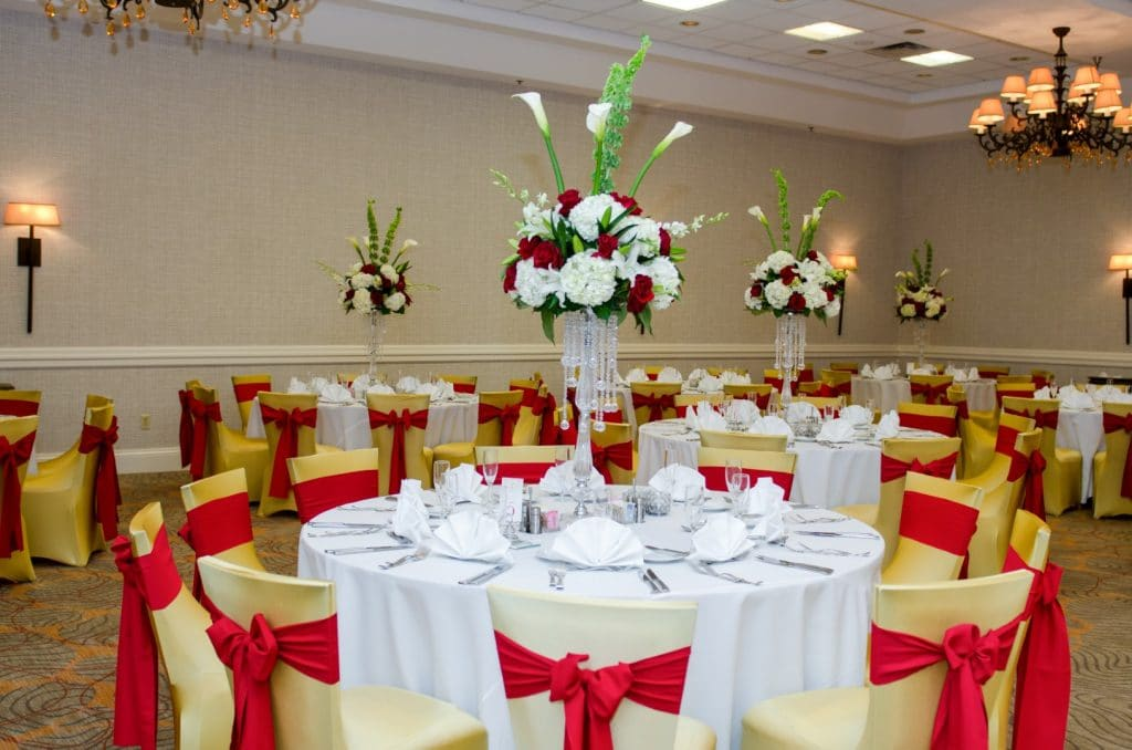 Renaissance-Orlando-Hotel-Airport-Red, Yellow and white table centerpieces at indoor reception