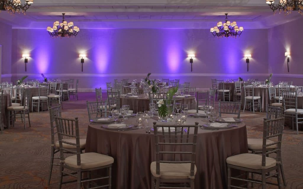 Renaissance-Orlando-Hotel-Airport-Basic grey/silver table setting and chairs with purple uplighting on walls