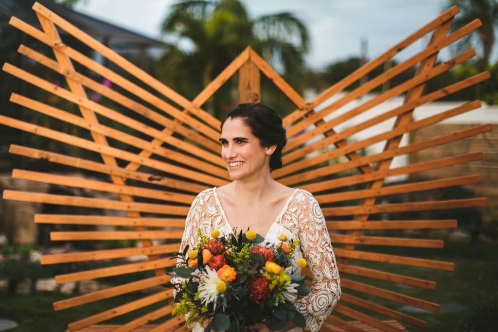 Rockledge Gardens - bride backed by wooden fan sculpture