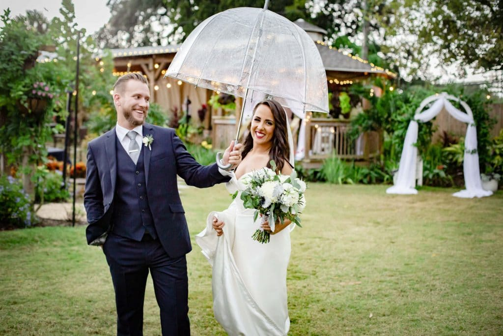 Rockledge Gardens - groom holding umbrella over smiling bride