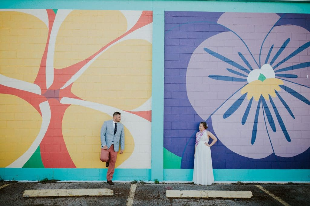 Rockledge Gardens - bride and groom against colorful murals