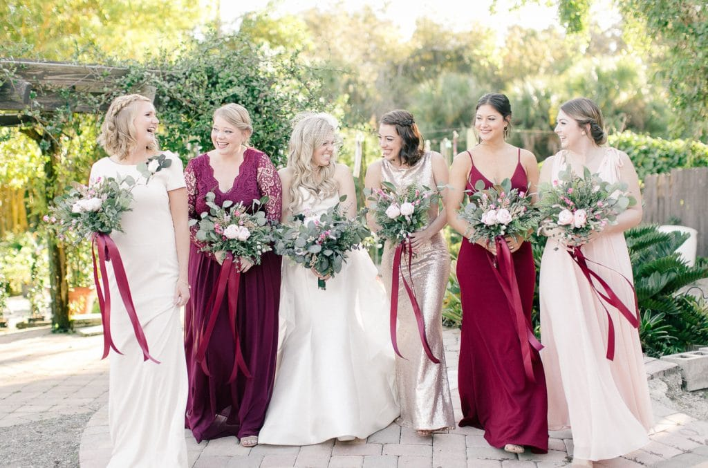 Rockledge Gardens - bride with her bridesmaids in different colors