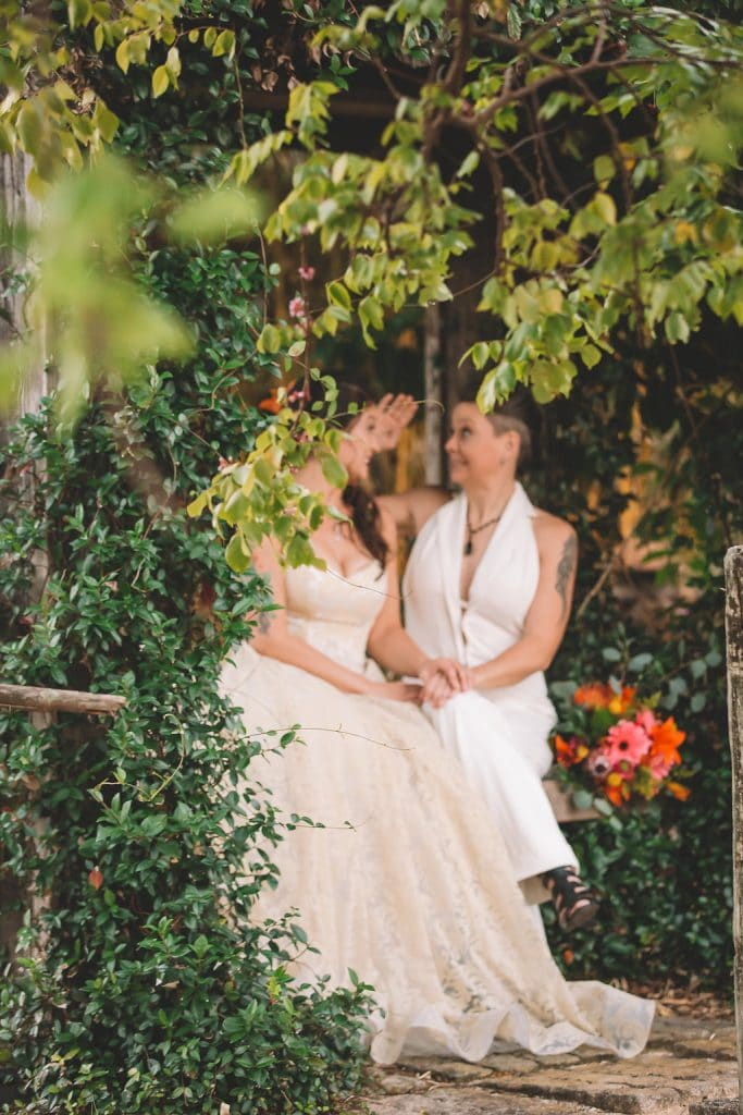 Rockledge Gardens - two brides in tropical garden setting