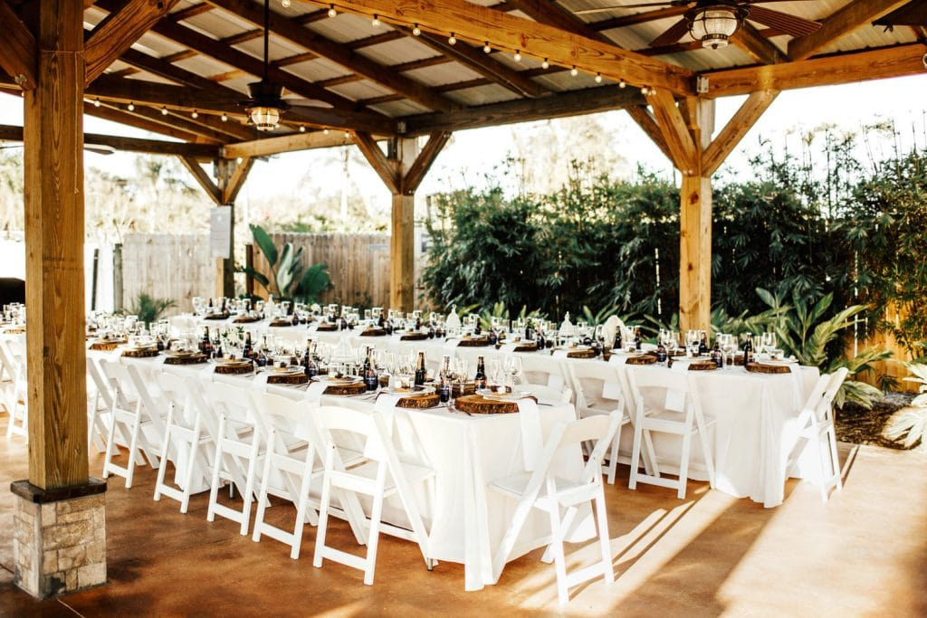 Rockledge Gardens - long reception tables under rustic pavilion