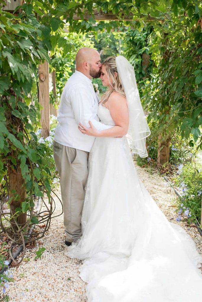 Rockledge Gardens - groom kissing bride's forehead
