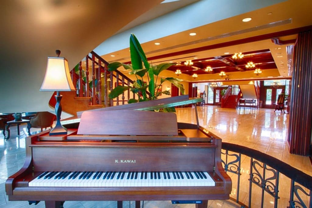 Tavares-Pavilion-on-the-Lake-Piano and entrance to stair case