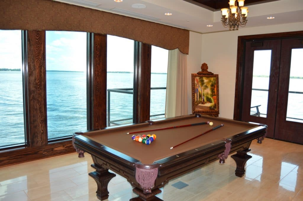 Tavares-Pavilion-on-the-Lake-Pool table with lake view and large french doors