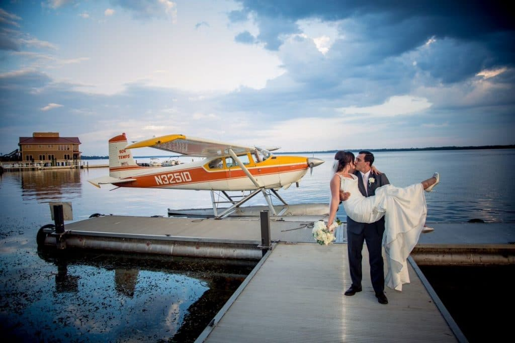 Tavares-Pavilion-on-the-Lake- Bride and Groom lakeside with a sea plan and venue in background