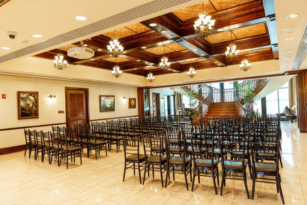 Tavares-Pavilion-on-the-Lake-Chairs set up for a ceremony in front of the stair case