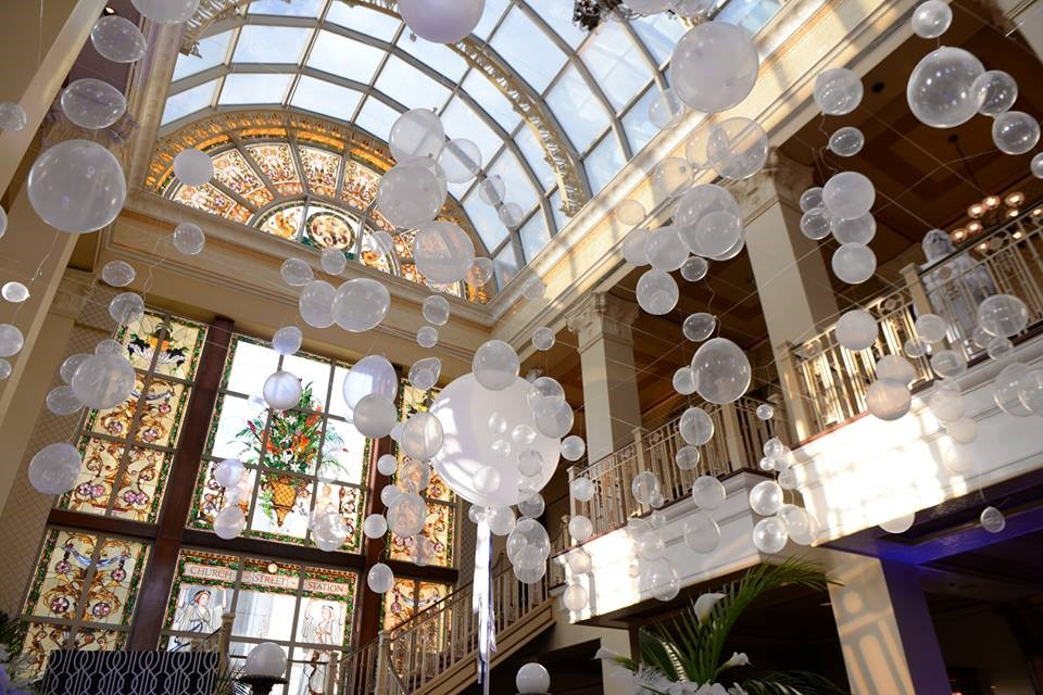 The-Ballroom-on-Church-Street-White balloon like decorations within building under glass archway