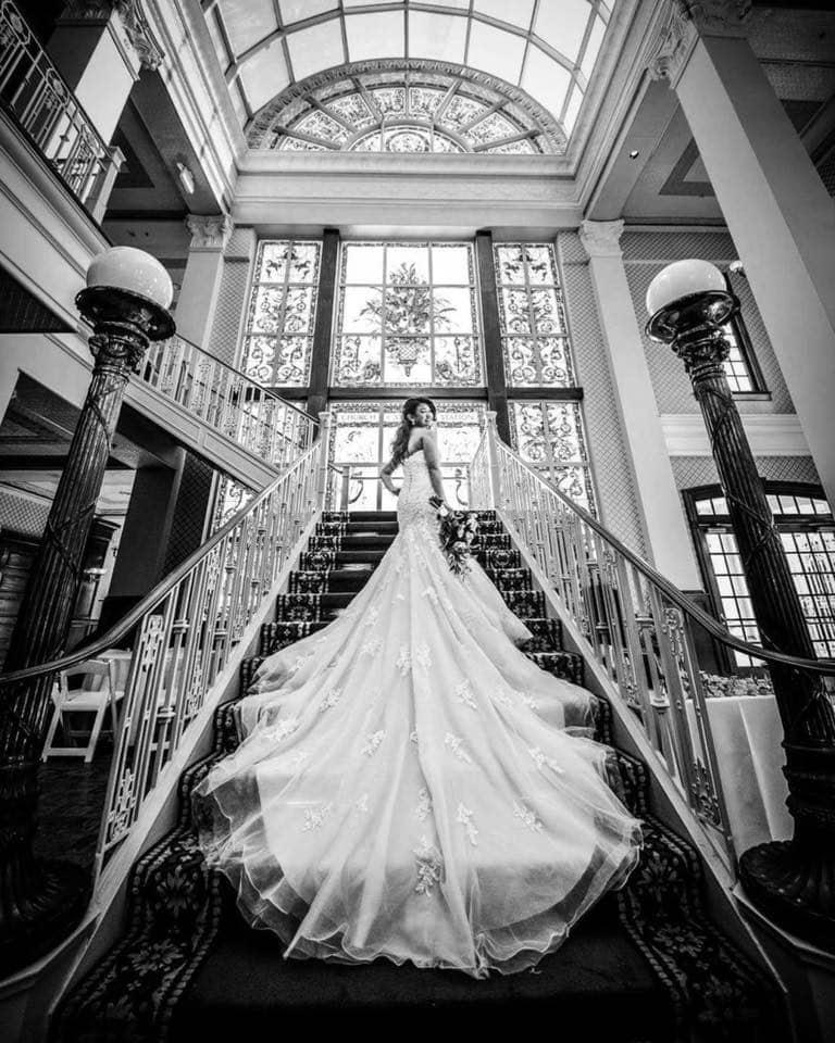 The-Ballroom-on-Church-Street-Bride standing on staircase displaying wedding dress