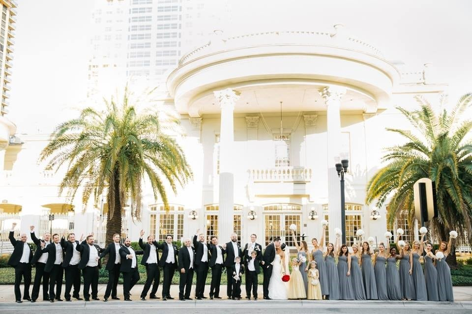 The-Ballroom-on-Church-Street-Bridal party and grooms men standing out front with Bride and Groom out front of building