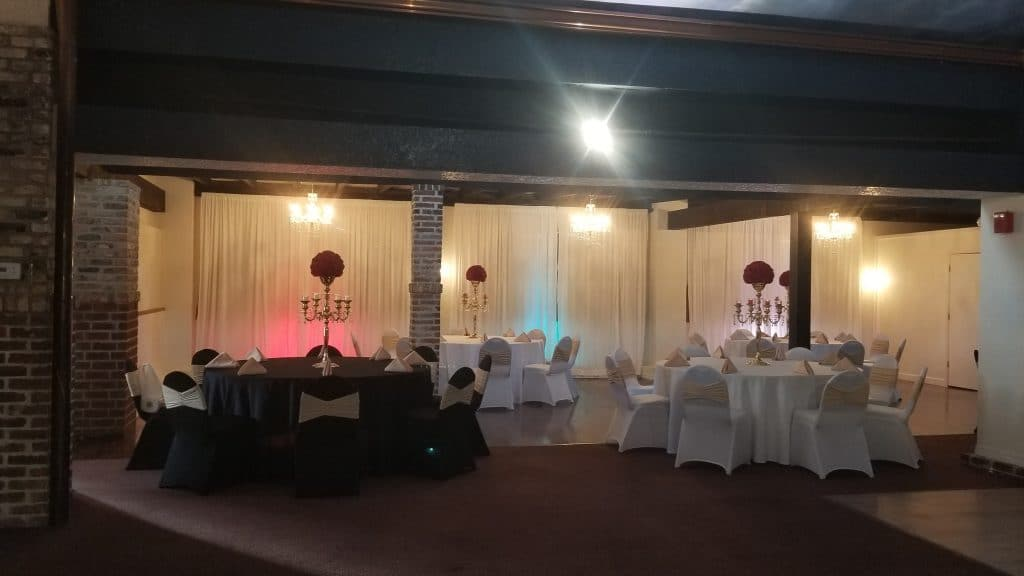 The Bella Room - black and white reception tables