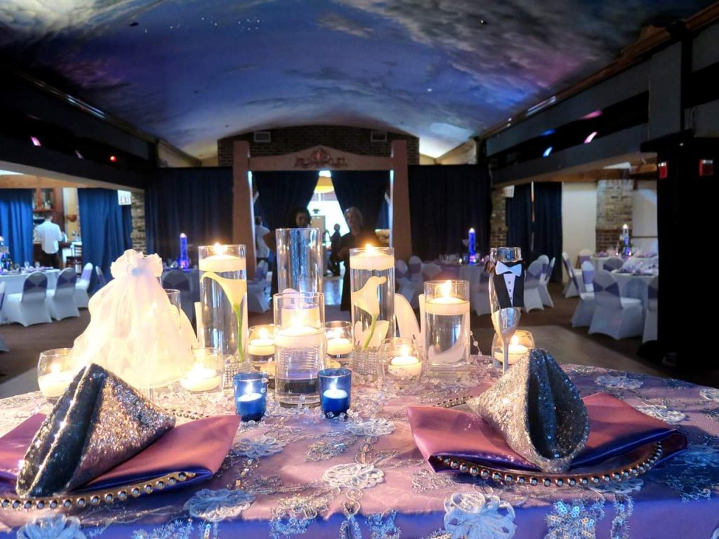 The Bella Room - glitzy sweetheart table looking onto reception room