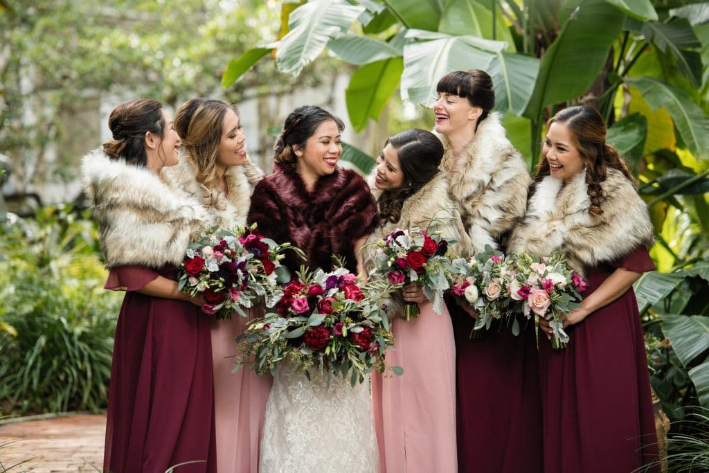 The Courtyard at Lake Lucerne - bridal party in fur shawls outside