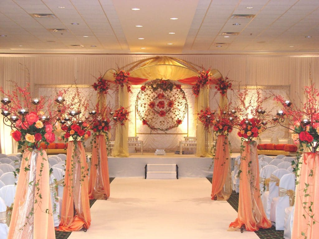The Florida Hotel and Conference Center - stunning ceremony setup with springs of flowers and gold canopy