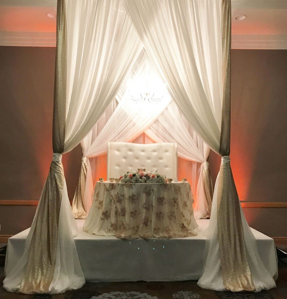 The Florida Hotel and Conference Center - romantic sweetheart table with curtained canopy