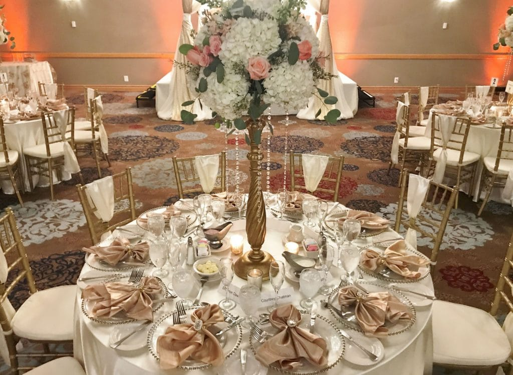 The Florida Hotel and Conference Center - reception table decorated in pinks and gold